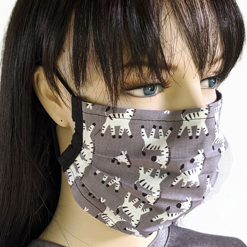 3 layer pleated folding style fabric face mask, featuring upside down zebras, one size