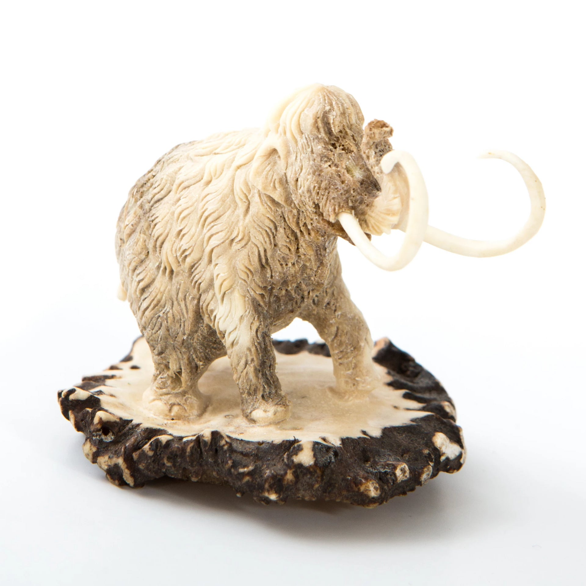 Carved mammoth with base