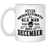 """Never Underestimate an Old Man Who Was Born In December""  Coffee Mug"