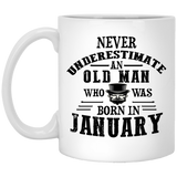 """Never Underestimate an Old Lady Who Was Born In........""  Coffee Mug"