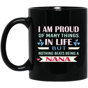 "I AM PROUD OF MANY THINGS IN LIFE, BUT NOTHING BEATS BEING A NANA"" COFFEE MUG (black)"
