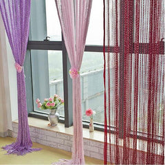 cascading glistening curtain strings