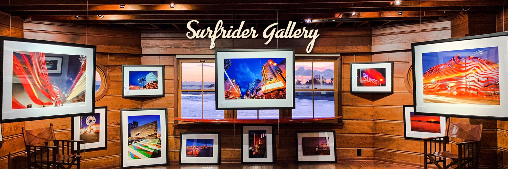 Surfrider Gallery | Multiple images hung on a wall made of wood