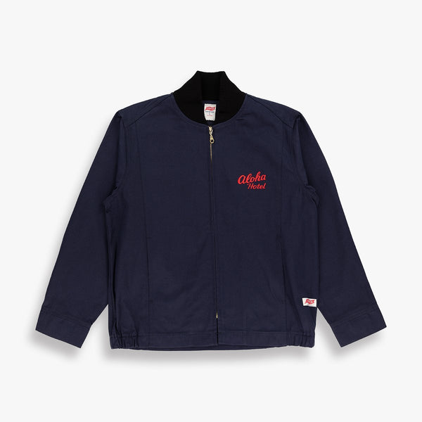 1960s Surf Club jacket with high definition embroidered design.  High definition embroidery featuring the logo of Palm Springs' Aloha Hotel, officially endorsed product.  Heavy navy cotton twill outer with taped seams, rib collar, nickel zipper and cats eye buttons.