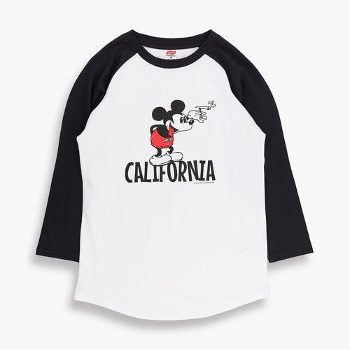 White baseball shirt with black sleeves. On the front is a design of mickey Mouse. and the word California underneath him. TSPTR brand