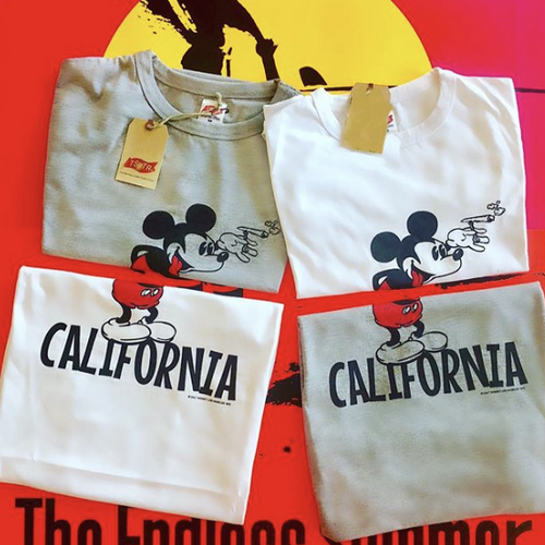 TSPTR California T-shirt. White and gray shirts with a design of mickey mouse on it with the word California underneath him.