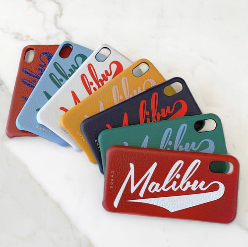 Chaos iphone case in red, blue, white, yellow, black and green. They all have the world malibu written across it and the logo chaos on the bottom.
