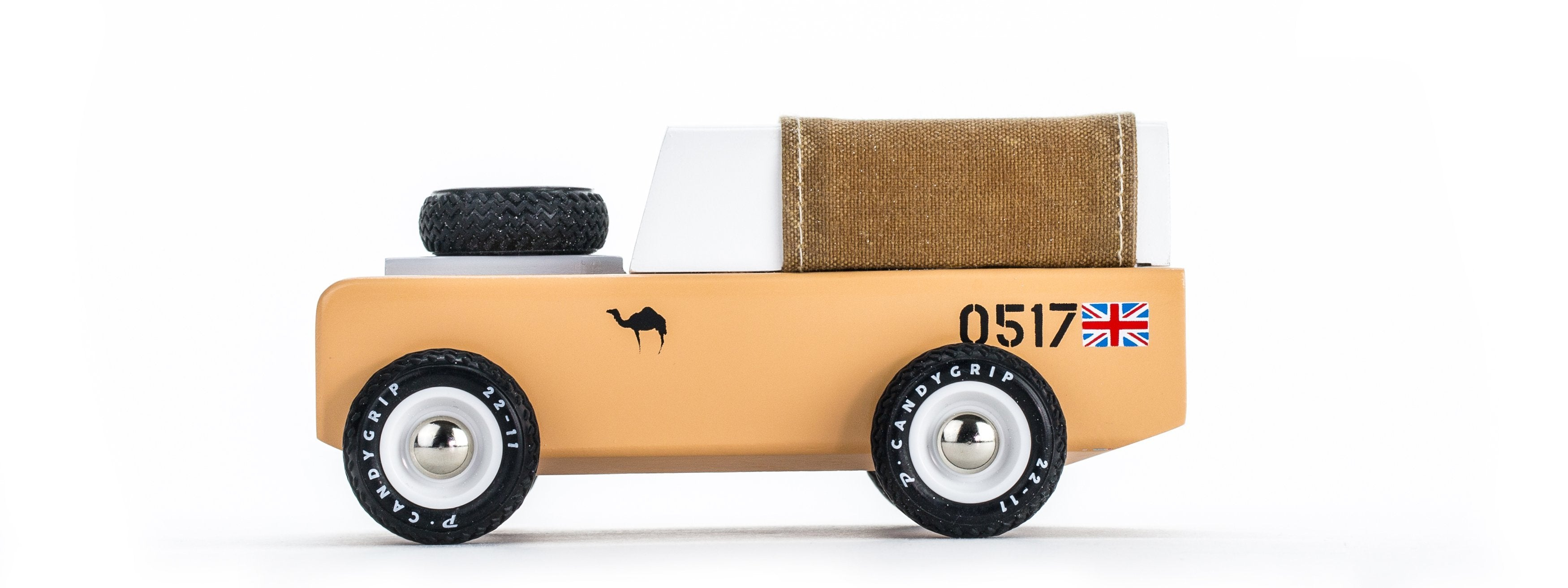 Candylab sahara truck. The body is tan and there is a spare wheel on the top at the front. Solid Beech Wood, water-based paint and clear urethane coat.  ABS plastic rims, with rubber tires.