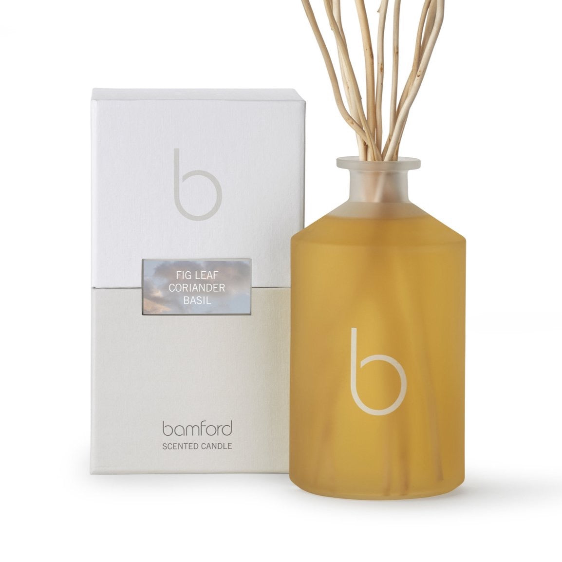 A white frosted glass bottle with sticks sticking out of the bottle. On the box it says Bamford scented candle willow diffuser refill 500ml.