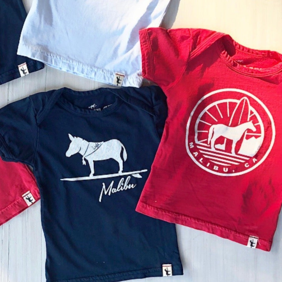 One Gun Ranch Sunrise Horse Kids T-Shirt. Red, white and blue shirts with Malibu design. 100% cotton. Made in Los Angeles