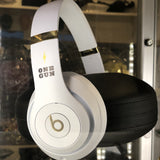 One Gun Beats Headphones. White headphones with silver accent designs.