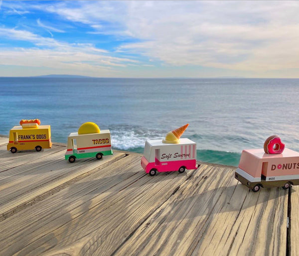 Mini LeToy Vans. One is a Frank's Dogs Truck, a Taco Truck, Soft serve truck, and donut truck.