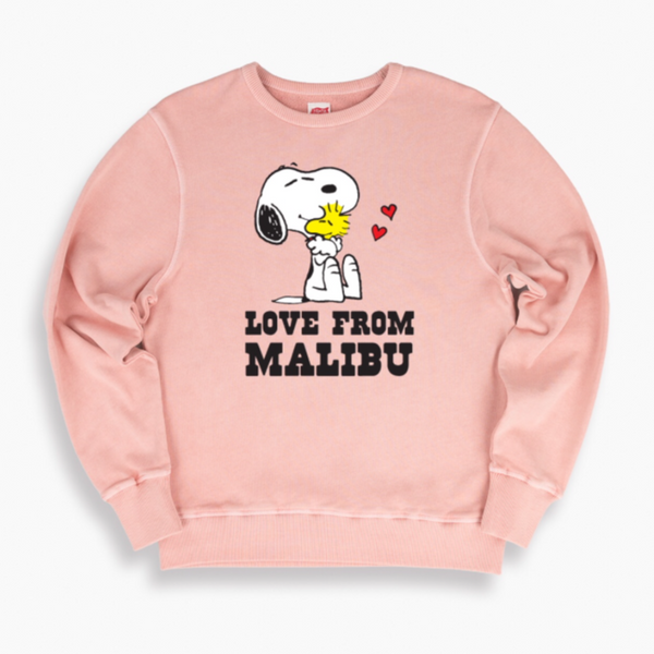TSPTR Love from Malibu Pullover. Pink sweater with the design of Snoopy hugging Woodstock on it. Love from Malibu is written below them.