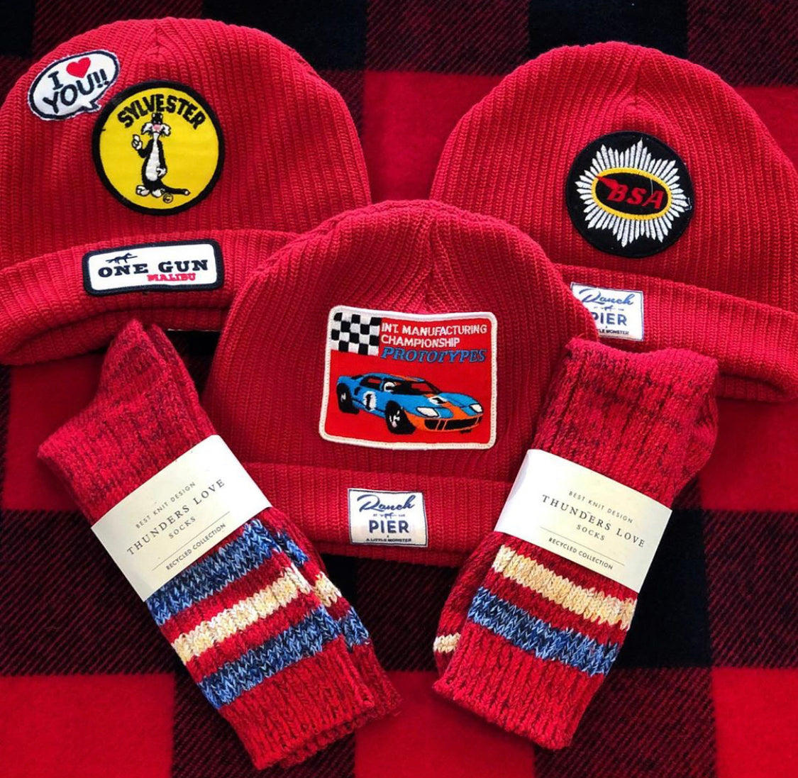 A bundle of red Momo Beanies (3x) Handcrafted by local Designer. Organic Cotton including Vintage Patches. One of a Kind Pendleton Twin Blanket  .Outsider Collection  Socks  (2x)