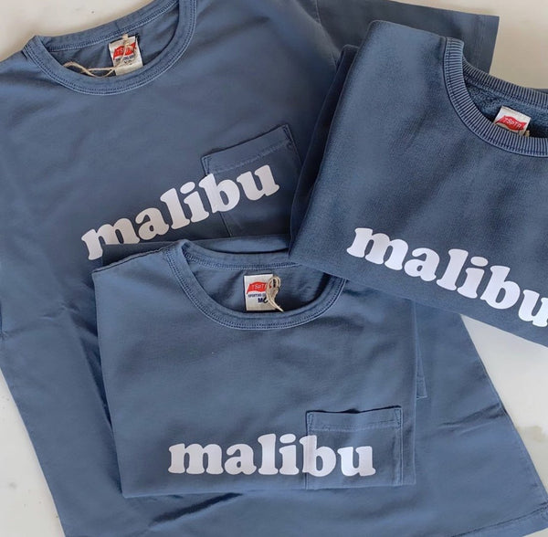 TSPTR Faded Navy Malibu Sweatshirt. blue sweatshirt with the word Malibu across the chest area in white text.