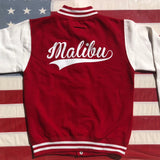On The Rise Malibu Varsity Jacket. A red jacket with white sleeves. Malibu written in white cursive text across the back.