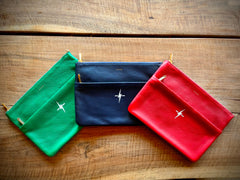 Green clutch, blue clutch, red clutch with lightning bolt