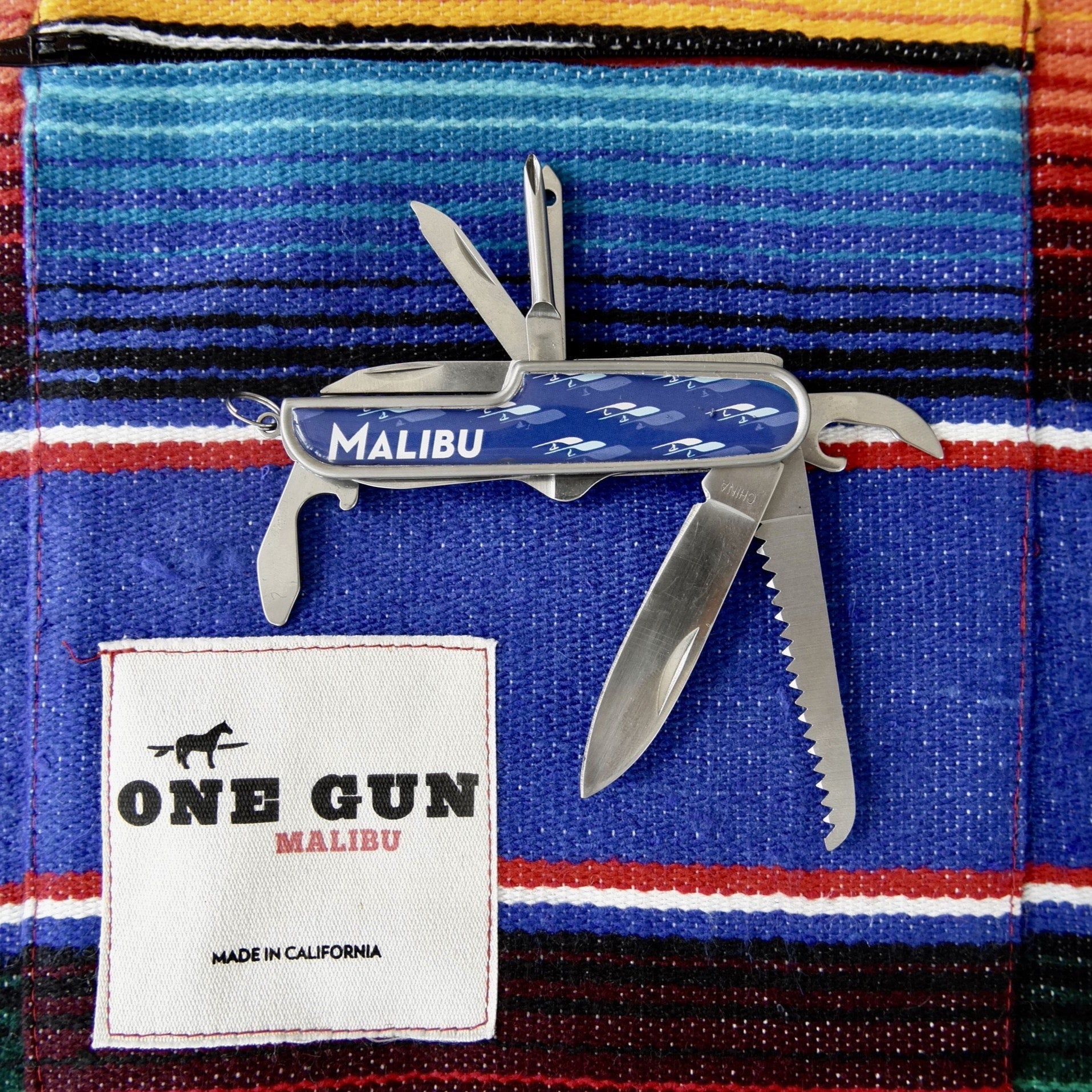 Malibu Pocket knife/Multi Tool. Has a knife, bottle opener, and screw