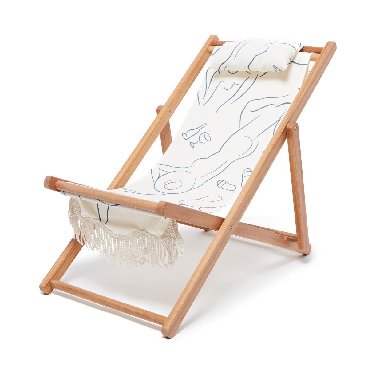 Business & Pleasure Le Basque Sling Chair. Wood rails and white fabric with a blue stripped design and a head pillow attached at the top.