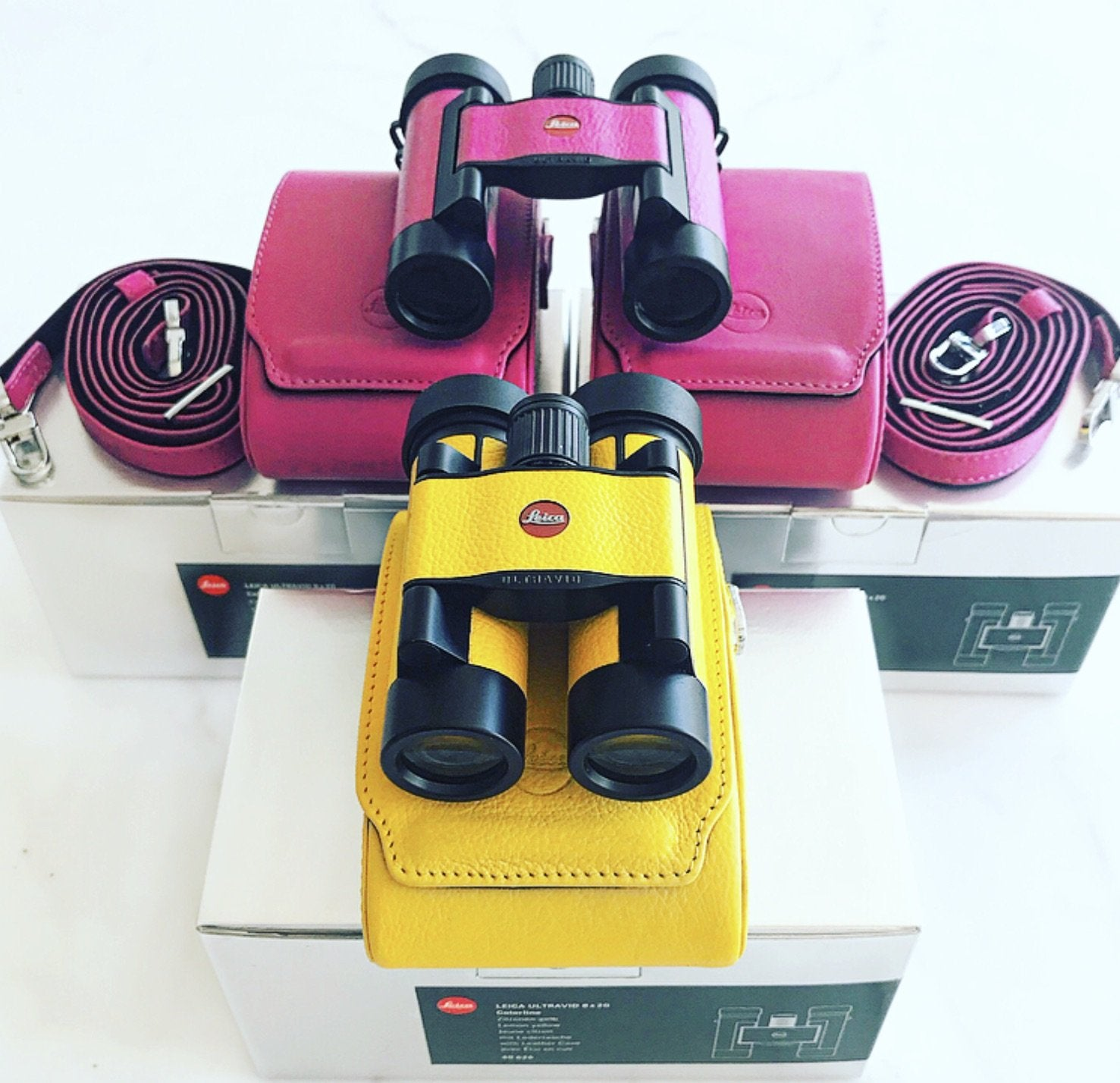 Leica Pink Binoculars. Comes with a pink case and matching color strap.