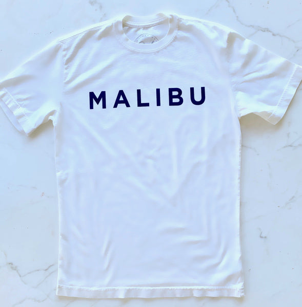 white Malibu t-shirt blue letters. The word Malibu is written across the chest in a slight arc. 100% cotton. Made in california