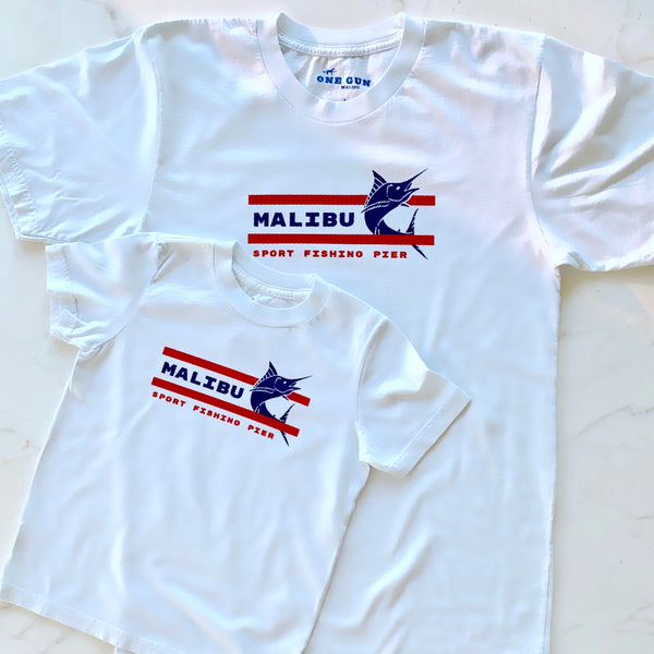 One Gun Malibu Fishing Pier T-shirt. White shirt with a blue and red design.