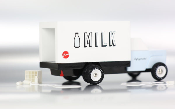 Candylab toy milk truck. Solid Beech wood, water-based paint, and clear urethane coat. White ABS plastic rims, with food-grade rubber tires.