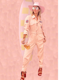 MOMO X One Gun Pink Jumpsuit in pink with multiple patches in the sleeve and the front pocket.