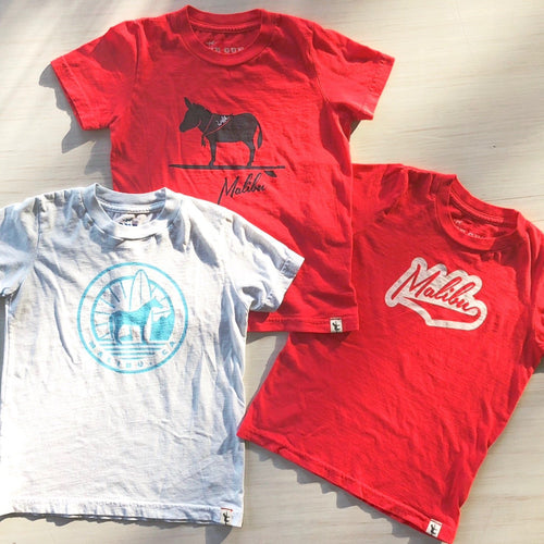One Gun Sunrise Kids T-Shirt Horse. Red and white shirts with malibu designs on them.