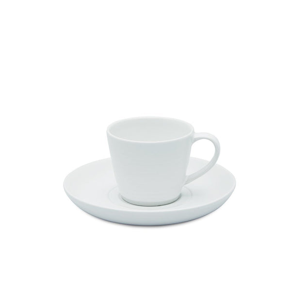 A white Daylesford espresso cup on a white saucer.