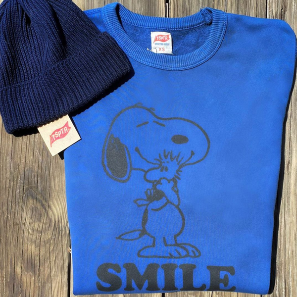 Blue Peanuts Smile Pullover with a design of snoopy hugging woodstock