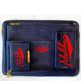 Blue Chaos X One Gun Leather Laptop Case with gold hardware and red text