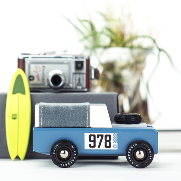 . A unique and perfectly engineered modern vintage toy with Real waxed canvas, a magnetic surfboard accessory and carefully crafted woodwork - all lovingly packed in an old school, string tie-down collectors box.
