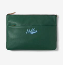 Chaos leather clutch with two zipper pockets. The word Malibu is written in blue cursive text in the center.