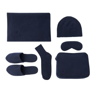 A navy Bamford travel blanket set. A large blanket, slippers, socket, a beanie, eye mask, and travel bag.