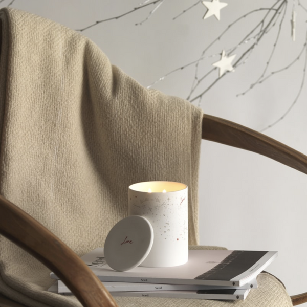 A calming, warm blend of woodsmoke and amber distilled into a natural wax and set into a starry night ceramic vessel.