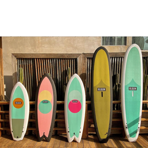 Album Surfboards ligned up in a row from shortest on the left, to longest on the right.
