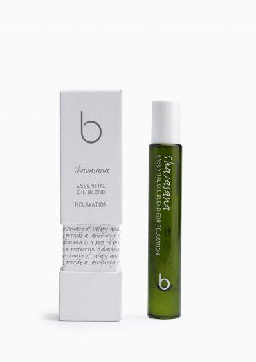 A green translucent bottle with a white twist on lid bottle and box say Bamford shavasana essential oil blend protection. 100% Organic ingredients, certified Organic by the Soil Association. 4 x 8ml