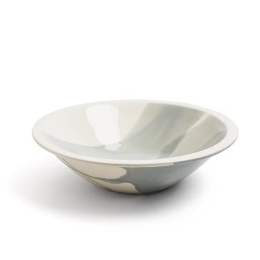 Daylesford sky soup bowl. The rims of both the bowls and platters are left without colour, creating a band with a transparent glaze. All these generous sized dishes are made in Portugal from earthenware clay.