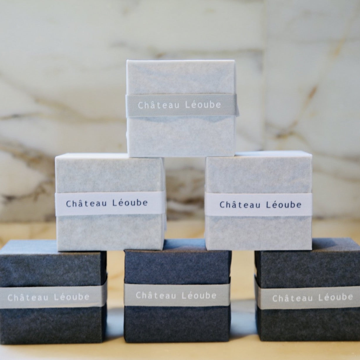 Chateau Leoube Soap wrapped in a white and black paper.