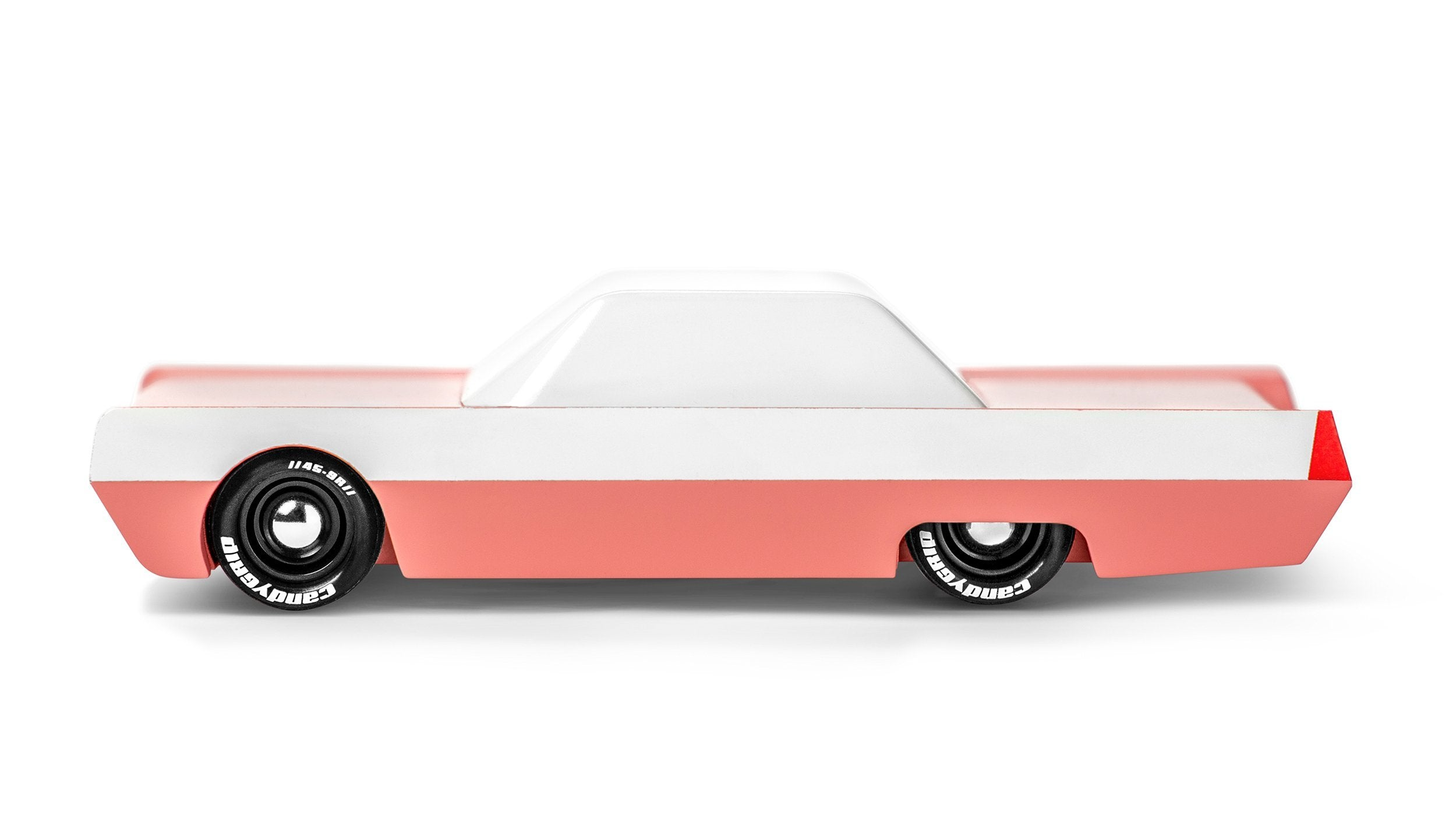 Candylab flamingo toy car. Two-tone paint fenders, white letter tires, and an attitude of barely restrained aggressivity.