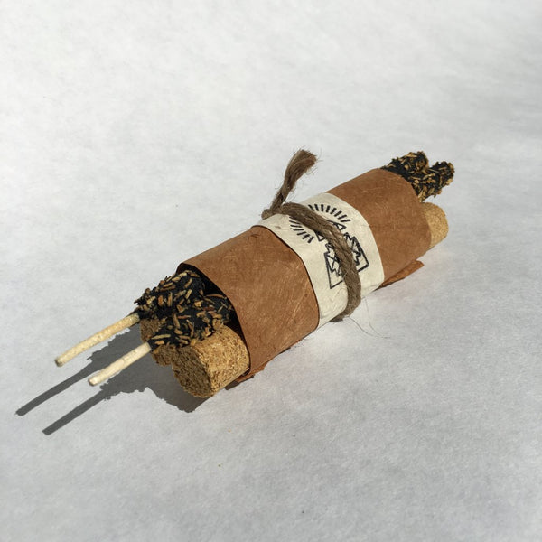 Hand-pressed pure Palo Santo incense cylinders bundled with Breu Resin & Palo Santo Incense Speckled Sticks using Traditional Nepalese Lokta paper from small cottage Women Enterprise.