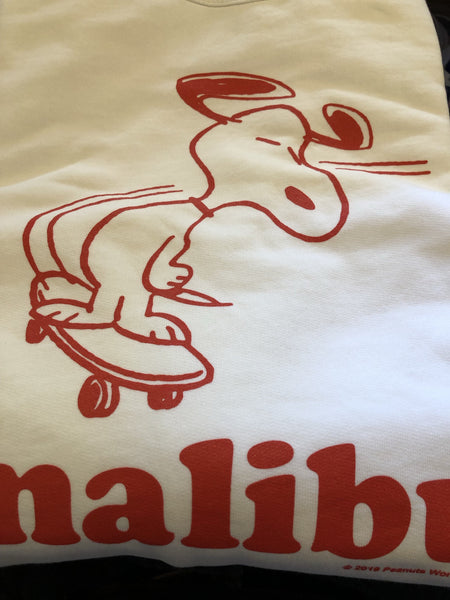TSPTR Malibu Skate Pullover. White shirt with a red design of Snoopy riding a skateboard on the front.