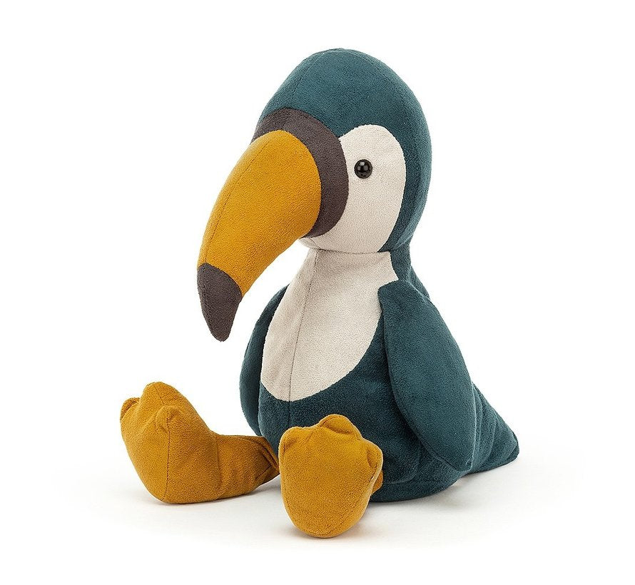 Jellycat belby toucan. Blue body, with white accents on the face and belly. It has orange legs and beak.