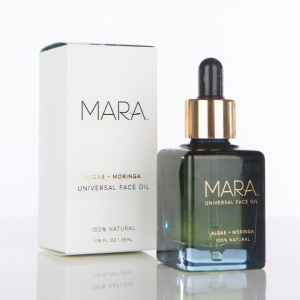 Mara Universal face oil in a green glass bottle with a dropper twist off lid. Vegan. Gluten Free. Soy Free. Cruelty Free. Synthetic Free. Alcohol Free. No Fragrance. No Parabens. No Added Color. No Phtlathlates. No PEGs.