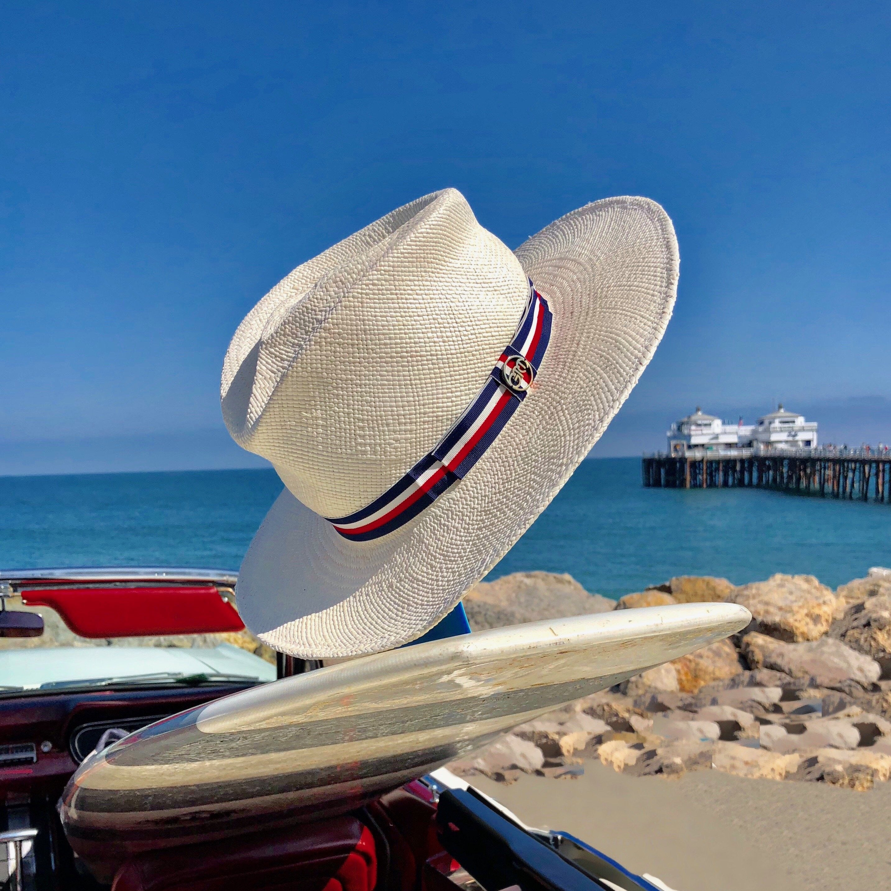 Gladys tamez Peck white hat with a red white and blue strip around the brim. 100% panama straw hat with striped grosgrain band  Measurements: Brim - 3""