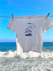 White  Peanuts Calif T-Shirt with a design of snoopy skateboarding.
