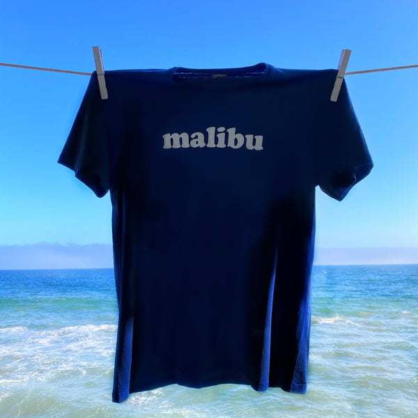 TSPTR Malibu T-Shirt. Blue shirt with the word Malibu on the chest in white text.