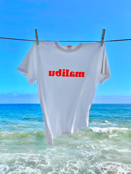 TSPTR Malibu T-Shirt. White shirt with malibu spelt backwards in Red text