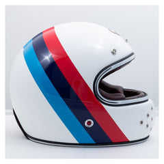 Ruby Motorcycle Helmet. Full carbon shell Sheepskin leather lined comfort foam interior 7 ventilation channels in crown of helmet 2 exhaust ports at back of neck roll 12 ventilation holes on the chin guard Hand painted Leather trimmed eyeport 3 shell sizes: XS-S, M-L, XL-2XL DOT approved. Red and blue stripe design.